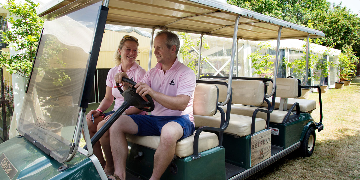Barny & Emily Lee on the golf buggy at The Retreat, Badminton Horse Trials