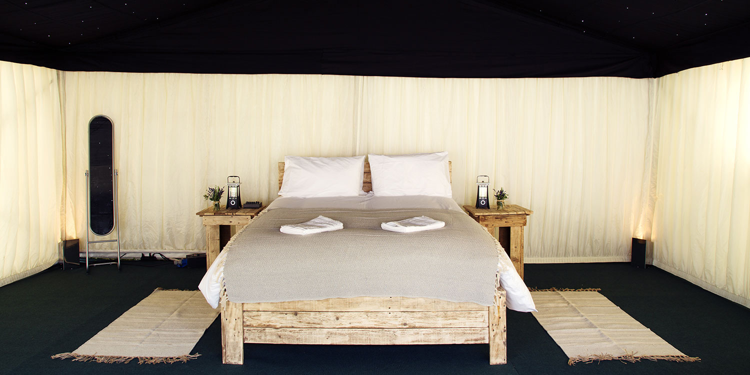 A luxury frame ten with wooden double bed and proper matress! Glamping with The Retreat at Badminton
