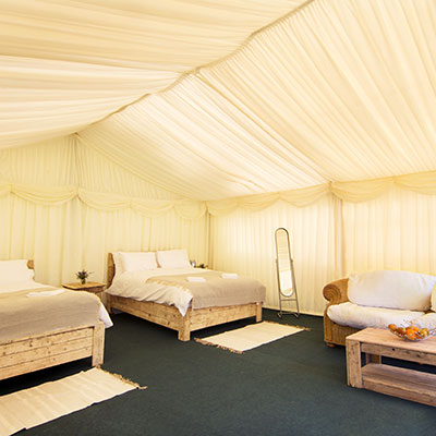 A luxury frame tent at The Retreat, Pilton, pop up glamping site for Badminton Horse Trials 2019