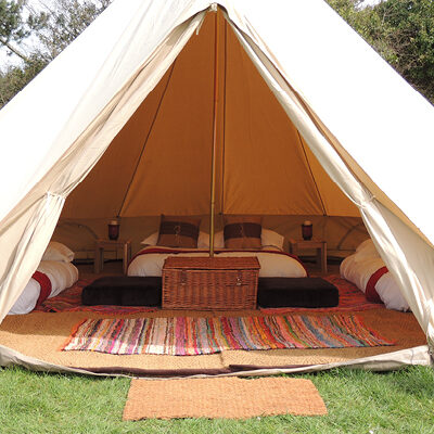 The interior of a furnished Bell Tent at The Retreat, Badminton Horse Trials luxury glampsite by Gate Ba