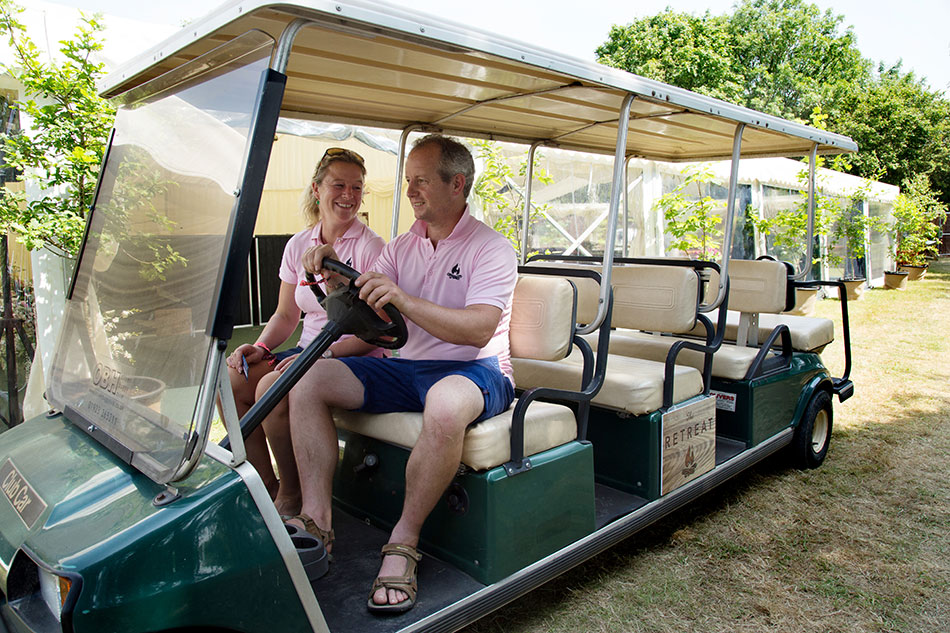 Barny and Em driving the company buggy at the Glastonbury retreat