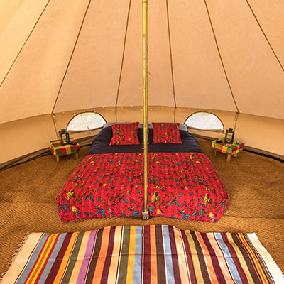 The interior of a 4 meter furnished Bell Tent at The Retreat