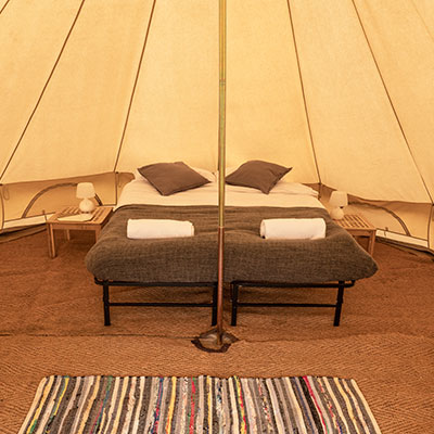 The interior of a furnished Bell Tent at The Retreat, Badminton Horse Trials luxury glamping accommodation