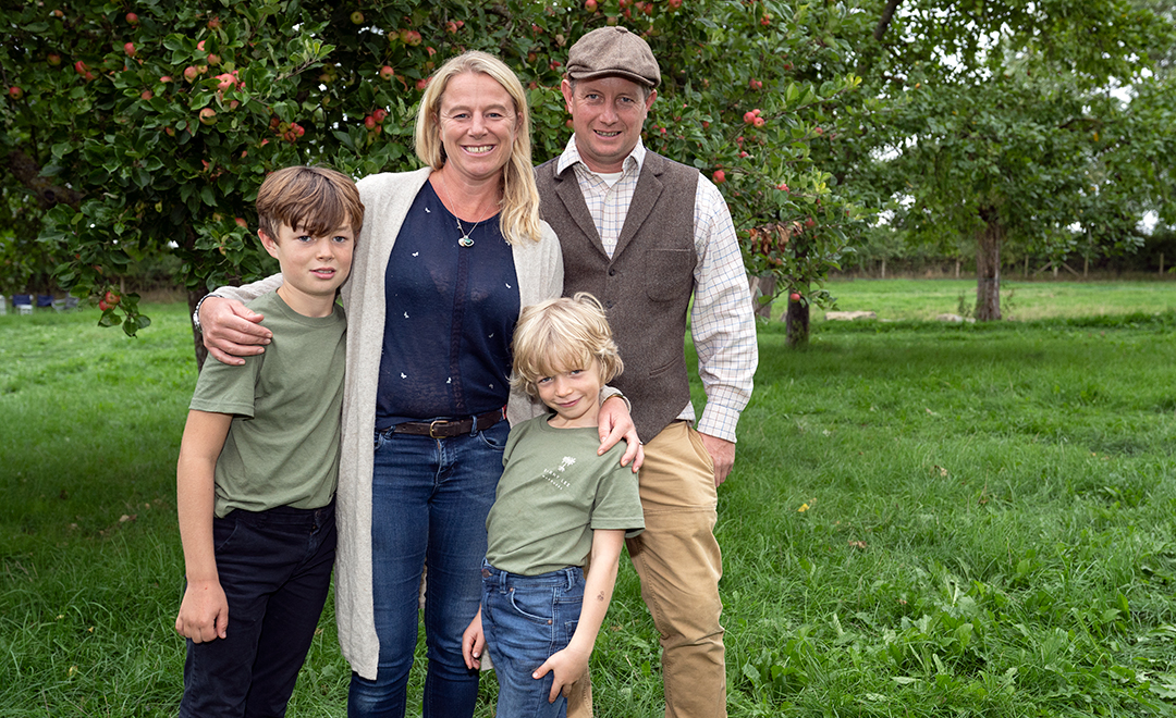 Family photo in Toby's orchard, Barny, Em, Jonny and George having some fun and smiling together.