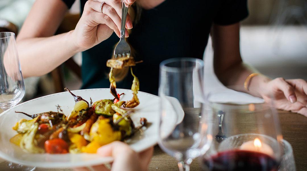 Close up of a lady dining at the Retreta restaurant at Badminton Horse Trials