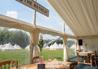 The restaurant overlooking the glamping field at the Badminton Retreat