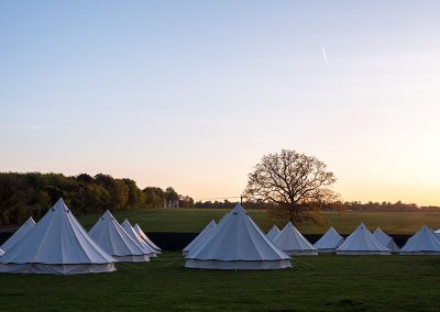 The glamping field at dusk at Badminton Horse Trials Badminton Retreat