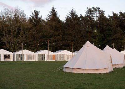 The glamping field at dusk at The Badminton Retreat