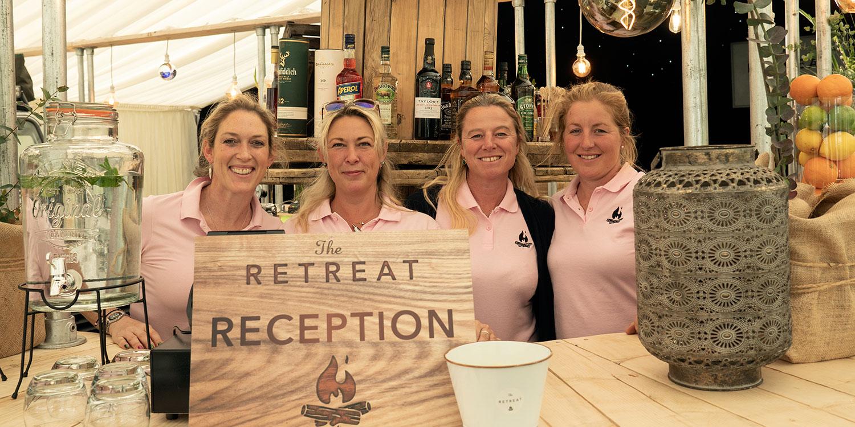 The staff behind The Badminton Retreat bar, glamping at Badminton Horse Trials